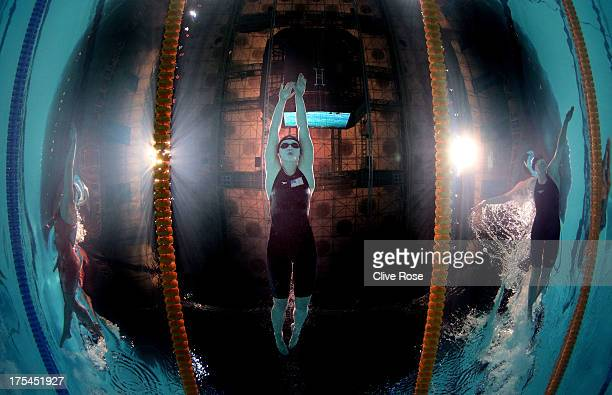 Katie Ledecky of the USA sets a new World Record time of 81386 alongside Lotte Friis of Denmark and Lauren Boyle of New Zealand in the Swimming...