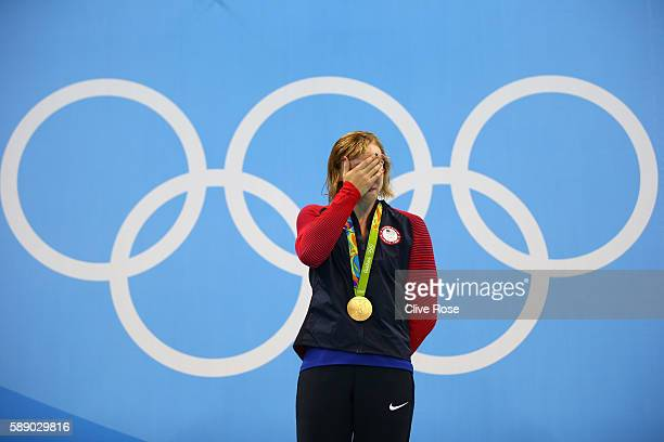 Katie Ledecky of United States celebrates on the podium after winning gold in the Women's 800m Freestyle Final on Day 7 of the Rio 2016 Olympic Games...