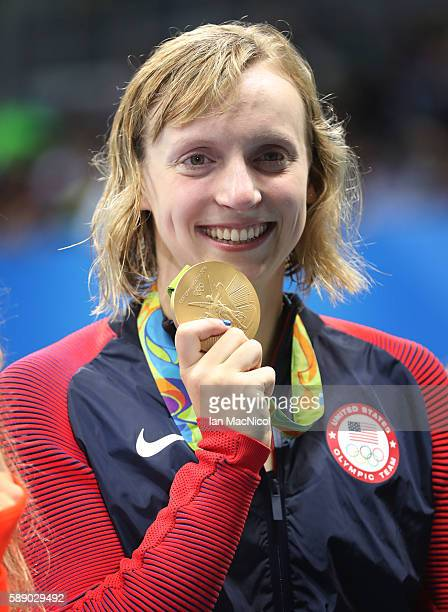 Katie Ledecky of Unites States poses with her Gold medal from the Women's 800m Freestyle on Day 7 of the Rio 2016 Olympic Games at the Olympic...