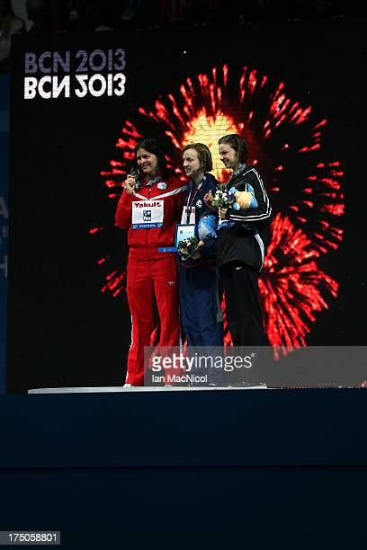 Katie Ledecky of USA who set a new world record and won the final of The Women's 1500m Freestyle with Lotte Friis of Denmark and Lauren Boyle of New...