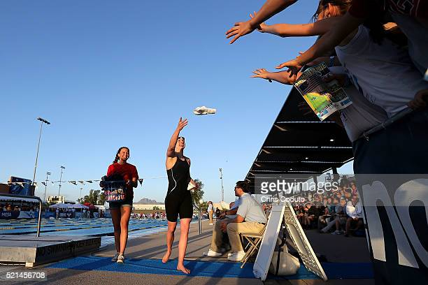 Katie Ledecky tosses an autographed shirt to fans after winning the women's 400 meter freestyle final at the Skyline Aquatic Center on April 15 2016...
