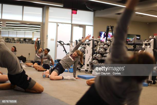 Katie Lou Samuelson and her team mates warming down and stretching under the supervision of strength coach Amanda Kimball during the The UConn...