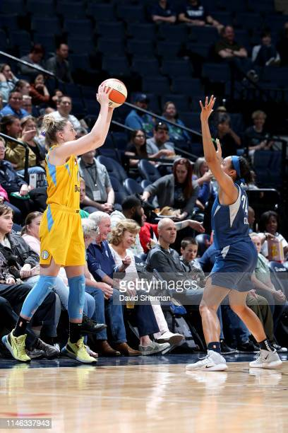 Katie Lou Samuelson of Chicago Sky looks to pass the ball while Napheesa Collier of Minnesota Lynx plays defense during the game on May 25 2019 at...