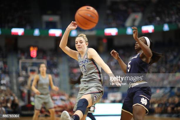 Katie Lou Samuelson of the Connecticut Huskies and Jackie Young of the Notre Dame Fighting Irish challenge for a rebound during the the UConn Huskies...