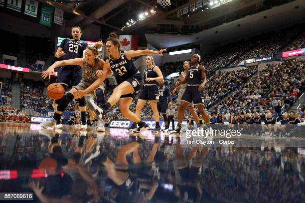 Katie Lou Samuelson of the Connecticut Huskies and Kathryn Westbeld of the Notre Dame Fighting Irish challenge for a loose ball during the the UConn...