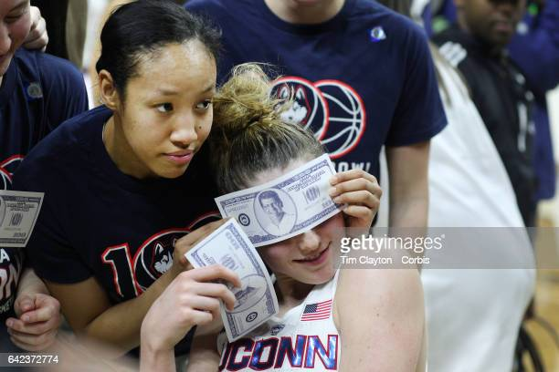 Katie Lou Samuelson of the Connecticut Huskies and Saniya Chong of the Connecticut Huskies celebrate the teams one hundredth consecutive win during...