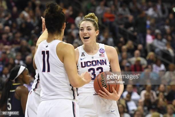 Katie Lou Samuelson of the Connecticut Huskies celebrates with Kia Nurse during the semifinal game of the 2018 NCAA Photos via Getty Images Division...