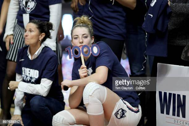 Katie Lou Samuelson of the Connecticut Huskies celebrating head coach Geno Auriemma of the UConn Huskies 1000th win during the Naismith Basketball...