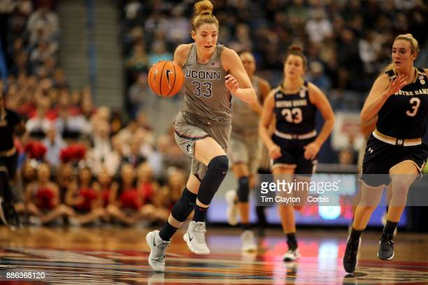 Katie Lou Samuelson of the Connecticut Huskies challenged by Marina Mabrey of the Notre Dame Fighting Irish during the the UConn Huskies Vs Notre...