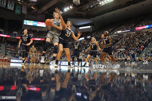 Katie Lou Samuelson of the Connecticut Huskies defended by Kathryn Westbeld of the Notre Dame Fighting Irish during the the UConn Huskies Vs Notre...