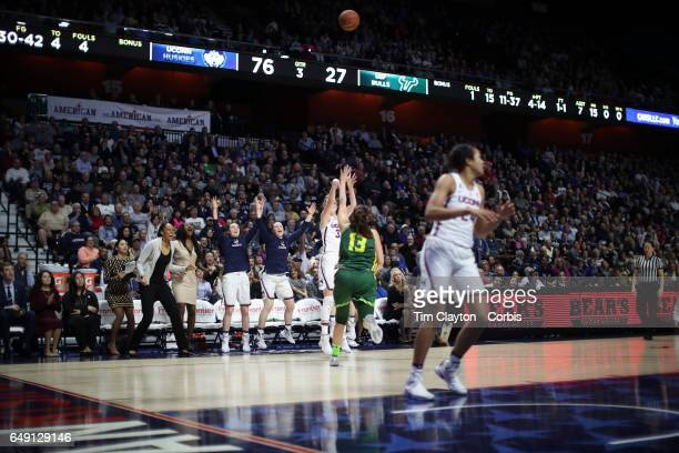 Katie Lou Samuelson of the Connecticut Huskies hits her tenth three pointer in a row in front of the UConn bench during the USF Vs UConn American...