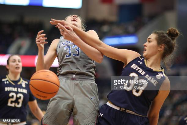 Katie Lou Samuelson of the Connecticut Huskies is challenged by Kathryn Westbeld of the Notre Dame Fighting Irish during the the UConn Huskies Vs...