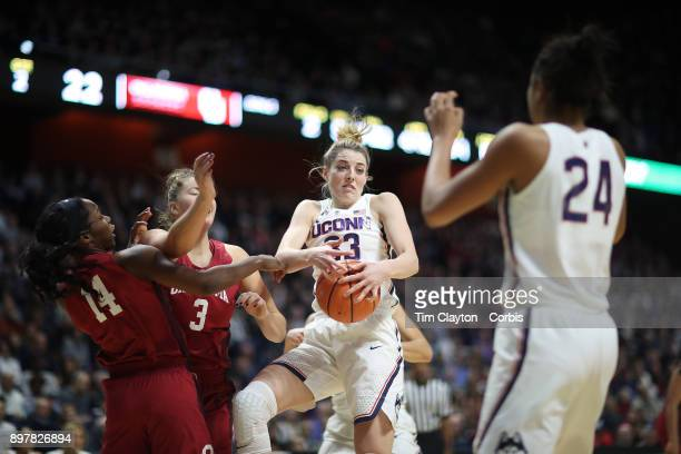 Katie Lou Samuelson of the Connecticut Huskies rebounds during the Naismith Basketball Hall of Fame Holiday Showcase game between the UConn Huskies...