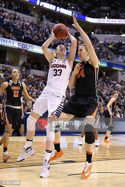Katie Lou Samuelson of the Connecticut Huskies shoots against Ruth Hamblin of the Oregon State Beavers in the first quarter during the semifinals of...