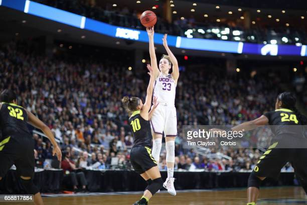 Katie Lou Samuelson of the Connecticut Huskies shoots for three while defended by Lexi Bando of the Oregon Ducks during the UConn Huskies Vs Oregon...