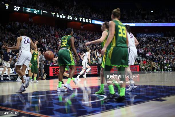 Katie Lou Samuelson of the Connecticut Huskies turns away after hitting her tenth three pointer in a row during the USF Vs UConn American Athletic...