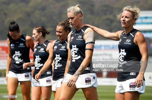 Katie Loynes and Tayla Harris of the Blues look dejected after a loss during the 2019 NAB AFLW Round 01 match between the North Melbourne Tasmanian...