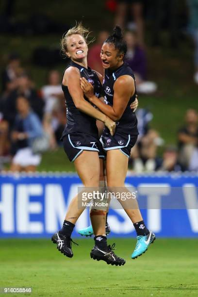 Katie Loynes of the Blues celebrates with Darcy Vescio of the Blues after scoring a goal during the round 20 AFLW match between the Greater Western...