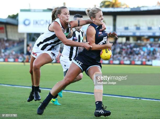 Katie Loynes of the Blues is tackled high by Ruby Schleicher of the Magpies during the round one AFLW match between the Carlton Blues and the...