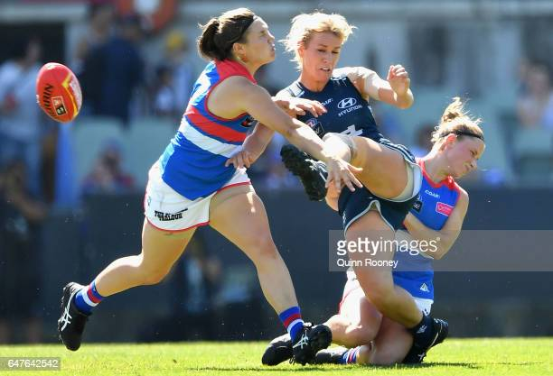 Katie Loynes of the Blues kicks whilst being tackled during the round five AFL Women's match between the Carlton Blues and the Western Bulldogs at...