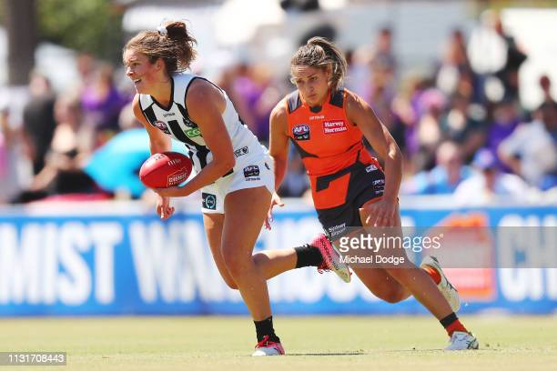 Katie Lynch of the Magpies runs with the ball from Louise Stephenson of GWS during the AFLW Rd 4 match between Collingwood and GWS at Morwekk...