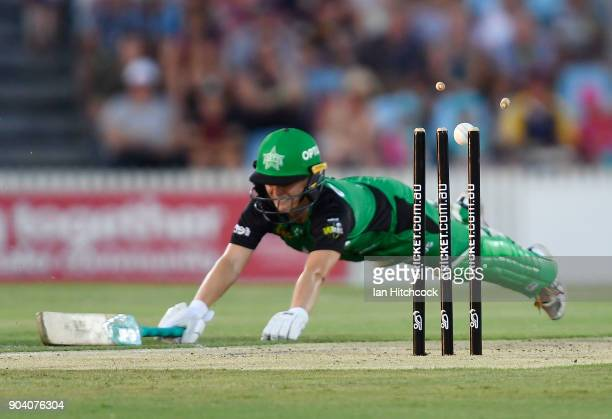 Katie Mack of the Stars makes her ground despite the ball hitting the stumps in a run out attempt during the the Women's Big Bash League match...