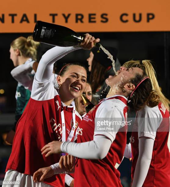 Katie McCabe and Emma Mitchell of Arsenal Women celebrate winning the Continenal Cup Trophy after the match between Arsenal Women and Manchester City...