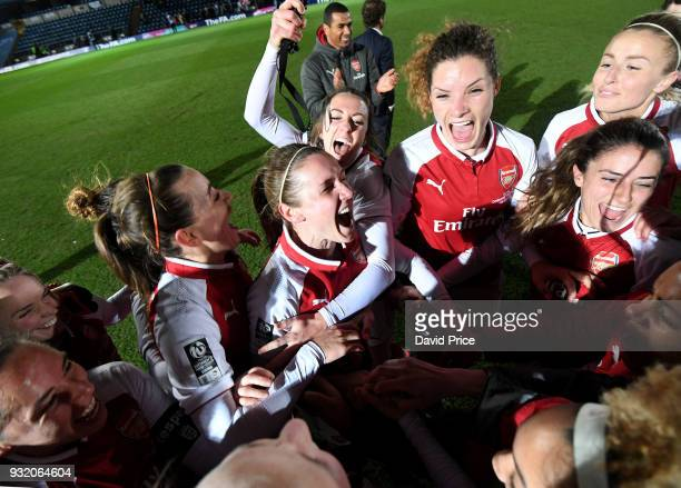 Katie McCabe Heather O'Reilly and Dominique Janssen of Arsenal Women celebrate winning the Continenal Cup Trophy after the match between Arsenal...