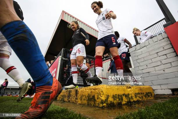 Katie McCabe of Arsenal and Niamh Fahley of Liverpool enter the pitch during the Barclays FA Women's Super League match between Arsenal and Liverpool...