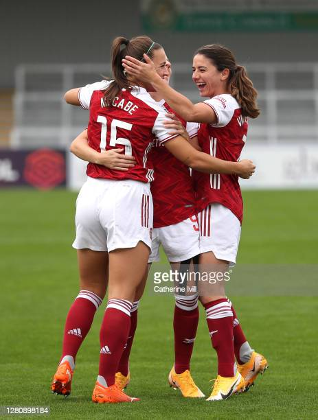 Katie McCabe of Arsenal celebrates with teammates after scoring her team's first goal during the Barclays FA Women's Super League match between...