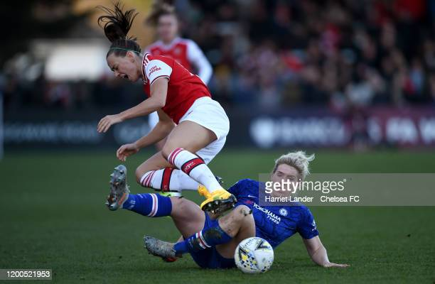 Katie McCabe of Arsenal is challenged by Millie Bright of Chelsea during the Barclays FA Women's Super League match between Arsenal and Chelsea at...