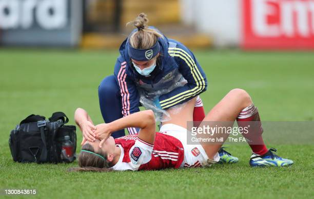 Katie McCabe of Arsenal receives medical treatment during the Barclays FA Women's Super League match between Arsenal Women and Manchester City Women...