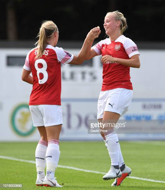 Katie McCabe of Arsenal takes on Lucienne Reichardt of West Ham during the match between Arsenal Women and West Ham United Women at Meadow Park on...