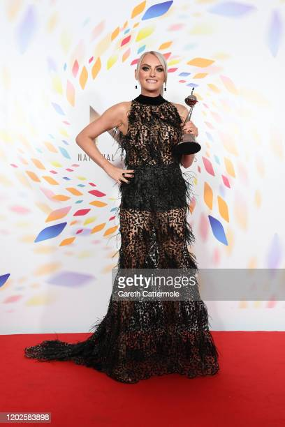 Katie McGlynn winner of the Drama Performance award for Coronation Street poses in the winners room attends the National Television Awards 2020 at...