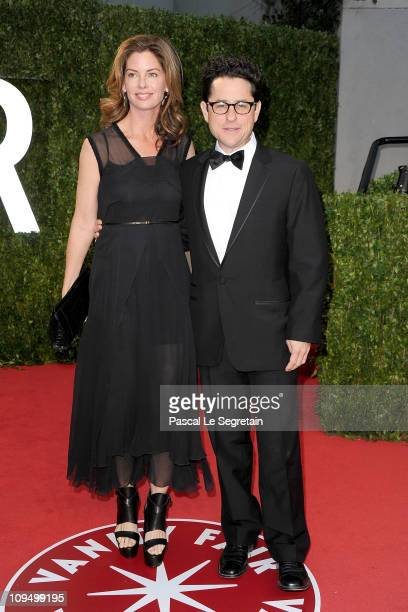 Katie McGrath and Producer JJ Abrams arrive at the Vanity Fair Oscar party hosted by Graydon Carter held at Sunset Tower on February 27 2011 in West...