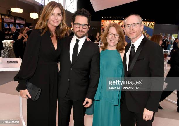 Katie McGrath filmmakerJJ Abrams actor Cheryl Howard and filmmaker Ron Howard attend the 2017 Vanity Fair Oscar Party hosted by Graydon Carter at...