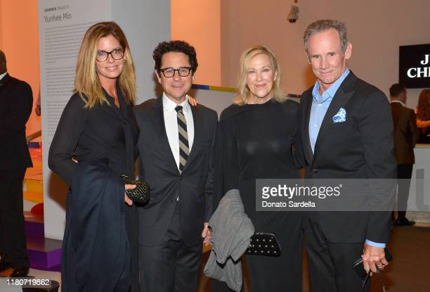 Katie McGrath JJ Abrams Catherine O'Hara and Bo Welch attend Hammer Museum's 17th Annual Gala In The Garden on October 12 2019 in Los Angeles...