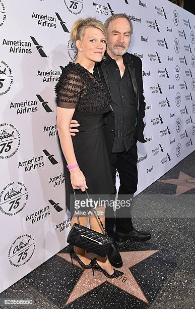 Katie McNeil and recording artist Neil Diamond attend Hollywood Gala celebrating Capitol Records 75th Anniversary on November 15 2016 in Los Angeles...