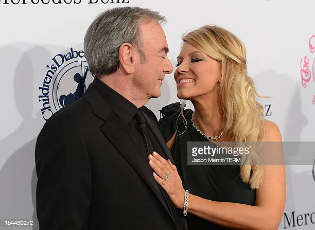 Katie McNeil and singer Neil Diamond arrive at the 26th Anniversary Carousel Of Hope Ball presented by MercedesBenz at The Beverly Hilton Hotel on...