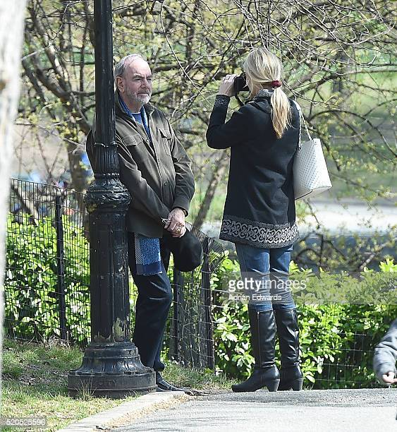 Katie McNeil takes photos of her husband Neil Diamond while out in Central Park on April 11 2016 in New York City