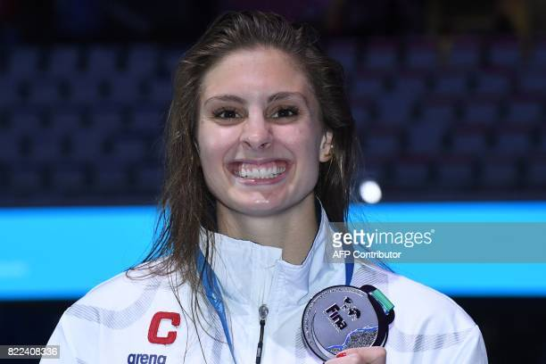 US Katie Meili celebrates on the podium after the women's 100m breaststroke final during the swimming competition at the 2017 FINA World...