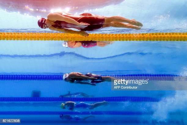 Katie Meili competes in a women's 100m breaststroke semifinal during the swimming competition at the 2017 FINA World Championships in Budapest on...