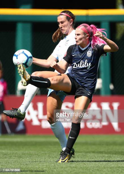 Katie Naughton of Chicago Red Stars and Addison Steiner of the Seattle Reign FC fight for the ball in the second half during their game at Cheney...