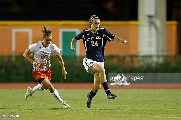 Katie Naughton of the Notre Dame Fighting Irish carries the ball past Amy Schmidt of the Miami Hurricanes on October 2 2015 at Cobb Stadium in Coral...