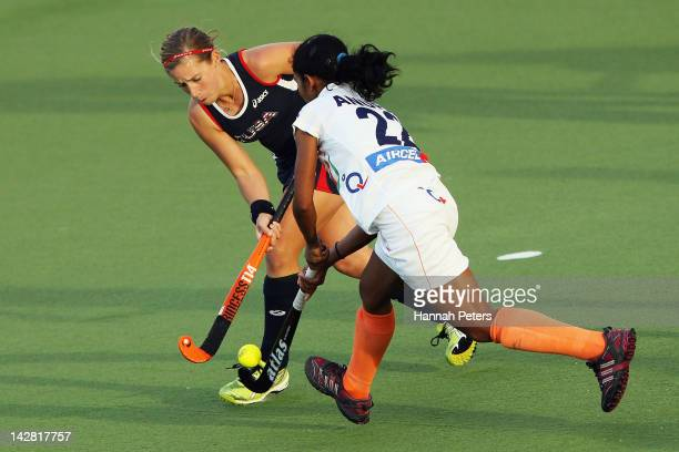 Katie O'Donnell of the USA competes for the ball with Anupa Barla of India during the Four Nations match between India and the United States of...