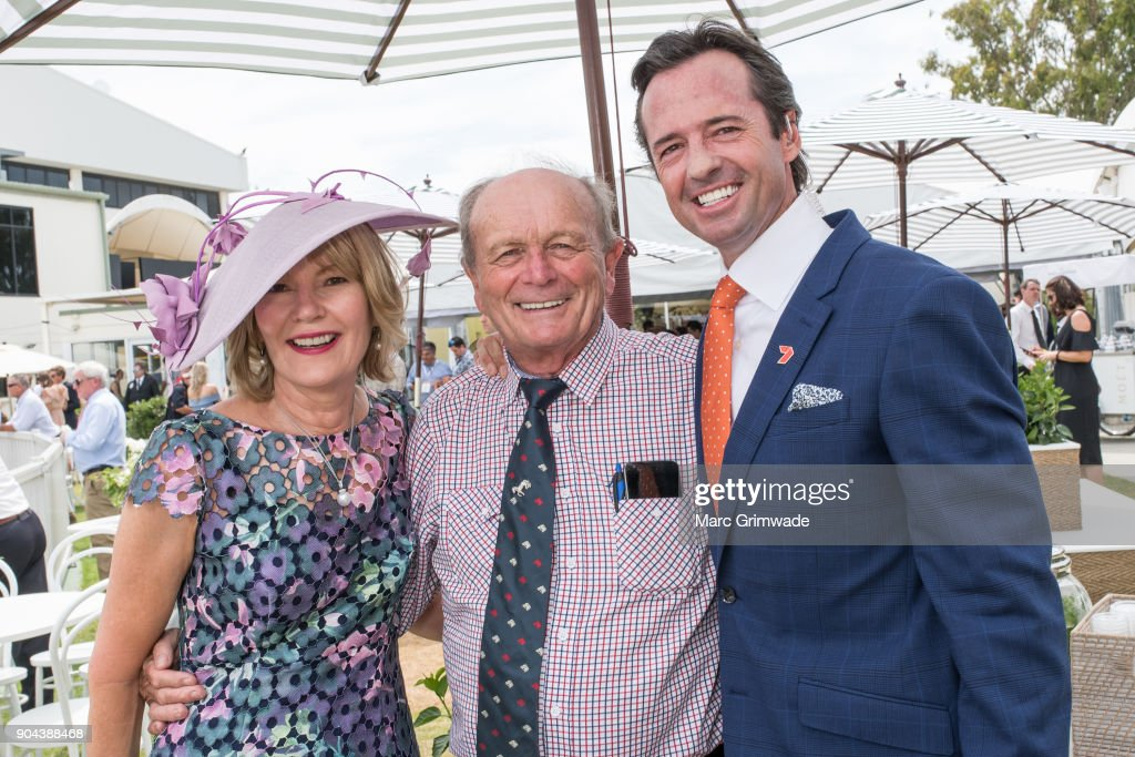 Katie Page & Gerry Harvey and Channel 7 identity Hamish McLachlan attend the Magic Millions Raceday on January 13, 2018 in Gold Coast, Australia.