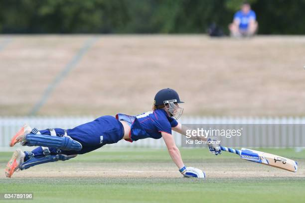 Katie Perkins of the Hearts dives to save her wicket during the Women's One Day Final match between Canterbury Magicians and Auckland Hearts on...