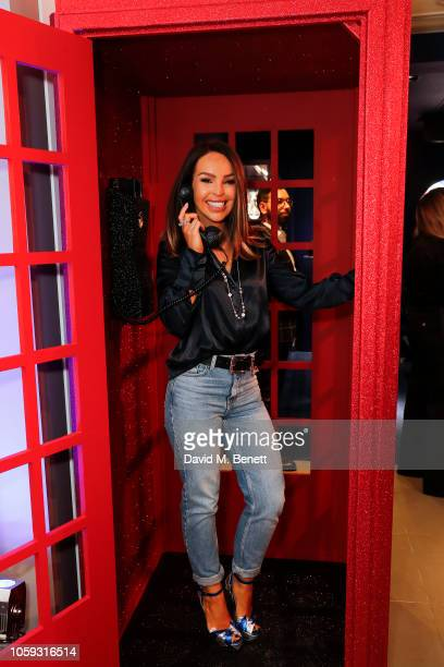 Katie Piper attends the opening of the newly designed Swarovski Oxford Street store featuring a selfie booth crystal styling suit personalisation bar...