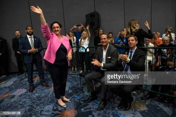 Katie Porter waves to the crowd after former US President Barack Obama introduced her at a Democratic Congressional Campaign Committee rally at the...