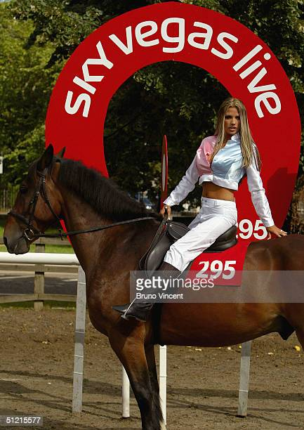 Katie Price also known as Jordan poses astride a thoroughbred horse in specially made jockey silks to promote new Sky live entertainment and betting...
